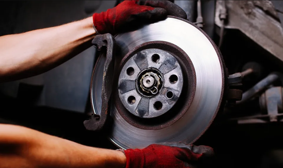 A person holding a brake rotor